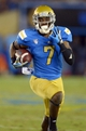 Aug 31, 2013; Pasadena, CA, USA; UCLA Bruins receiver Devin Fuller (7) carries the ball against the Nevada Wolf Pack at the Rose Bowl. UCLA defeated Nevada 58-20. Mandatory Credit: Kirby Lee-USA TODAY Sports