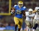 Aug 31, 2013; Pasadena, CA, USA; UCLA Bruins running back Malcolm Jones (28) carries the ball against the Nevada Wolf Pack at the Rose Bowl. UCLA defeated Nevada 58-20. Mandatory Credit: Kirby Lee-USA TODAY Sports