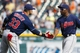 Sep 1, 2013; Detroit, MI, USA; Cleveland Indians player Nick Swisher (33) and teammate Mike Aviles (4) celebrate after the game against the Detroit Tigers at Comerica Park. Cleveland won 4-0. Mandatory Credit: Rick Osentoski-USA TODAY Sports