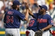 Sep 1, 2013; Detroit, MI, USA; Cleveland Indians relief pitcher Chris Perez (54) and Mike Aviles (4) celebrate after the game against the Detroit Tigers at Comerica Park. Cleveland won 4-0. Mandatory Credit: Rick Osentoski-USA TODAY Sports