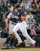 Sep 1, 2013; Houston, TX, USA; Houston Astros catcher Jason Castro (15) scores on a suicide squeeze play during the eighth inning against the Seattle Mariners at Minute Maid Park. Mandatory Credit: Troy Taormina-USA TODAY Sports
