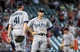 Sep 1, 2013; Houston, TX, USA; Seattle Mariners relief pitcher Charlie Furbush (41) and second baseman Nick Franklin (20) react after a play during the eighth inning against the Houston Astros at Minute Maid Park. Mandatory Credit: Troy Taormina-USA TODAY Sports