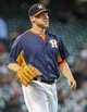 Sep 1, 2013; Houston, TX, USA; Houston Astros starting pitcher Brett Oberholtzer (65) smiles after a play during the ninth inning against the Seattle Mariners at Minute Maid Park. Mandatory Credit: Troy Taormina-USA TODAY Sports