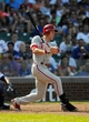 Sep 1, 2013; Chicago, IL, USA; Philadelphia Phillies second baseman Chase Utley (26) singles to right field during the eighth inning against the Chicago Cubs at Wrigley Field. Mandatory Credit: Reid Compton-USA TODAY Sports
