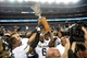 Sep 1, 2013; Denver, CO, USA; Colorado Buffaloes raise the centennial cup following the win over the Colorado State Rams at Sports Authority Field at Mile High. The Buffaloes defeated the Rams 41-27. Mandatory Credit: Ron Chenoy-USA TODAY Sports