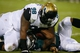 Aug 24, 2013; Jacksonville, FL, USA; Jacksonville Jaguars defensive tackle T. J. Barnes (98) brings Philadelphia Eagles running back Matthew Tucker (39) to the ground in the fourth quarter of their game at EverBank Field. The Philadelphia Eagles beat the Jacksonville Jaguars 31-24. Mandatory Credit: Phil Sears-USA TODAY Sports