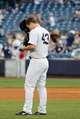 Sep 2, 2013; Bronx, NY, USA;  New York Yankees relief pitcher Adam Warren (43) takes a moment before pitching during the ninth inning against the Chicago White Sox at Yankee Stadium. Yankees won 9-1.  Mandatory Credit: Anthony Gruppuso-USA TODAY Sports