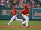 Sep 1, 2013; Anaheim, CA, USA; Los Angeles Angels third baseman Luis Jimenez (18) bobbles a ground ball by Tampa Bay Rays shortstop Yuriel Escobar (not pictured) as Angels shortstop Erick Aybar (2) backs up the play in the second inning at Angel Stadium. Mandatory Credit: Kirby Lee-USA TODAY Sports