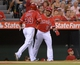 Sep 1, 2013; Anaheim, CA, USA; Los Angeles Angels right fielder J.B. Shuck (39) is congratulated by third baseman Luis Jimenez (18) after scoring in the third inning against the Tampa Bay Rays at Angel Stadium. Mandatory Credit: Kirby Lee-USA TODAY Sports