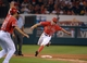 Sep 1, 2013; Anaheim, CA, USA; Los Angeles Angels center fielder Peter Bourjos (25) rounds third base in the sixth inning as third base coach Dino Ebell (21) gestures against the Tampa Bay Rays at Angel Stadium. Mandatory Credit: Kirby Lee-USA TODAY Sports