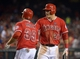 Sep 1, 2013; Anaheim, CA, USA; Los Angeles Angels left fielder Mike Trout (27) congratulates right fielder J.B. Shuck (39) after Shuck scored in the sixth inning against the Tampa Bay Rays at Angel Stadium. Mandatory Credit: Kirby Lee-USA TODAY Sports