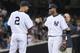 Sep 3, 2013; Bronx, NY, USA; New York Yankees shortstop Eduardo Nunez (26) and designated hitter Derek Jeter (2) celebrate after a game against the Chicago White Sox at Yankee Stadium. Mandatory Credit: Brad Penner-USA TODAY Sports