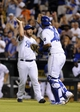 Sep 3, 2013; Kansas City, MO, USA; Kansas City Royals relief pitcher Greg Holland (56) celebrates with catcher Salvador Perez (13) after the game against the Seattle Mariners at Kauffman Stadium. The Royals won the game 4-3. Mandatory Credit: John Rieger-USA TODAY Sports