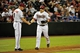 Sept 3, 2013; Phoenix, AZ, USA; Arizona Diamondbacks catcher Miguel Montero (26) celebrates with third base coach Matt Williams (9) after hitting solo home run during the seventh inning against the Toronto Blue Jays  at Chase Field. Mandatory Credit: Matt Kartozian-USA TODAY Sports