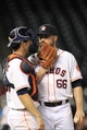 Sep 3, 2013; Houston, TX, USA; Houston Astros relief pitcher Kevin Chapman (66) talks to catcher Cody Clark (39) against the Minnesota Twins during the twelfth inning at Minute Maid Park. The Twins won 9-6. Mandatory Credit: Thomas Campbell-USA TODAY Sports