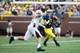 Aug 31, 2013; Ann Arbor, MI, USA; Michigan Wolverines quarterback Shane Morris (7) rolls out to pass against the Central Michigan Chippewas at Michigan Stadium. Mandatory Credit: Rick Osentoski-USA TODAY Sports