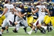 Aug 31, 2013; Ann Arbor, MI, USA; Michigan Wolverines wide receiver Da'Mario Jones (14) runs the ball against the Central Michigan Chippewas at Michigan Stadium. Mandatory Credit: Rick Osentoski-USA TODAY Sports