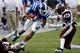 Aug 31, 2013; Durham, NC, USA; Duke Blue Devils wide receiver Johnell Barnes (4) runs the ball against North Carolina Central Eagles defensive back Sayyid Muhammad (39) at Wallace Wade Stadium. Mandatory Credit: Mark Dolejs-USA TODAY Sports
