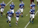 Aug 31, 2013; Durham, NC, USA; Duke Blue Devils linebacker Kyler Brown (56) and defensive end Jonathan Woodruff (34) and linebacker Deion Williams (48) and defensive tackle A.J. Wolf (93) and nose tackle Carlos Wray (98) and safety Corbin McCarthy (26) and defensive end Dezmond Johnson (42) run off the field against the North Carolina Central Eagles at Wallace Wade Stadium. Mandatory Credit: Mark Dolejs-USA TODAY Sports