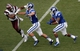 Aug 31, 2013; Durham, NC, USA; Duke Blue Devils running back Josh Snead (9) runs the ball as wide receiver Max McCaffrey (87) blocks North Carolina Central Eagles defensive back Tim Thaniel (3) at Wallace Wade Stadium. Mandatory Credit: Mark Dolejs-USA TODAY Sports