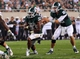 Aug 30, 2013; East Lansing, MI, USA; Michigan State Spartans quarterback Andrew Maxwell (10) hands the ball off to running back Jeremy Langford (33) during 1st half of a game at Spartan Stadium.   Mandatory Credit: Mike Carter-USA TODAY Sports