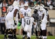 Aug 30, 2013; East Lansing, MI, USA; Western Michigan Broncos quarterback Zach Terrell (11) calls a play in the Western Michigan Broncos huddle during 2nd  half of a game at Spartan Stadium. MSU won 26-13.   Mandatory Credit: Mike Carter-USA TODAY Sports