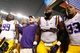 Aug 31, 2013; Arlington, TX, USA;  LSU Tigers defensive tackle Greg Gilmore (99), head coach Les Miles,defensive tackle Anthony Johnson (90) and running back Jeremy Hill (33) sing after the game against the TCU Horned Frogs at Cowboys Stadium. LSU Tigers beat TCU Horned Frogs 37-27. Mandatory Credit: Tim Heitman-USA TODAY Sports