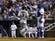 Sep 4, 2013; Kansas City, MO, USA; Seattle Mariners catcher Mike Zunino (3) scores against the Kansas City Royals in the third inning at Kauffman Stadium. Mandatory Credit: John Rieger-USA TODAY Sports