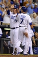 Sep 4, 2013; Kansas City, MO, USA; Kansas City Royals designated hitter Billy Butler (16) and right fielder David Lough (7) celebrate after scoring against the Seattle Mariners in the fourth inning at Kauffman Stadium. Mandatory Credit: John Rieger-USA TODAY Sports