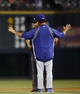 Sep 4, 2013; Denver, CO, USA; Los Angeles Dodgers manager Don Mattingly (front) argues a call with second base umpire Larry Vanover (back) during the third inning against the Colorado Rockies at Coors Field. Mandatory Credit: Chris Humphreys-USA TODAY Sports
