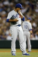 Sep 4, 2013; Denver, CO, USA; Los Angeles Dodgers pitcher Edinson Volquez (30) reacts on the mound after giving up a run during the third inning against the Colorado Rockies at Coors Field. Mandatory Credit: Chris Humphreys-USA TODAY Sports