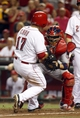 Sep 4, 2013; Cincinnati, OH, USA; Cincinnati Reds center fielder Shin-Soo Choo (17) is tagged out at home by St. Louis Cardinals catcher Yadier Molina (4) in the 15th inning at Great American Ball Park. St. Louis won 5-4. Mandatory Credit: David Kohl-USA TODAY Sports