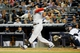 Sep 5, 2013; Bronx, NY, USA;  Boston Red Sox third baseman Will Middlebrooks (16) hits a home run to left during the fourth inning against the New York Yankees at Yankee Stadium. Mandatory Credit: Anthony Gruppuso-USA TODAY Sports