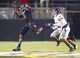 September 5, 2013; Greenville, NC, USA;  East Carolina wide receiver Justin Hardy (2) makes a 1st quarter catch in front of Florida Atlantic defensive back Cre'von LeBlanc  (7) at Bagwell Field at Dowdy-Ficklen Stadium. Mandatory Credit: James Guillory-USA TODAY Sports