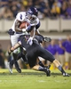 September 5, 2013; Greenville, NC, USA;  Florida Atlantic running back Jonathan Wallace (27) is tackled by the East Carolina defensive back Damon Maqazu (11) during the 2nd quarter at Bagwell Field at Dowdy-Ficklen Stadium. Mandatory Credit: James Guillory-USA TODAY Sports