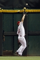 Sep 5, 2013; Cincinnati, OH, USA; Cincinnati Reds right fielder Jay Bruce (32) makes a catch during the eighth inning against the St. Louis Cardinals at Great American Ball Park. The Reds defeated the Cardinals 6-2. Mandatory Credit: Frank Victores-USA TODAY Sports