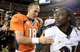 Sep 5, 2013; Denver, CO, USA;  Denver Broncos quarterback Peyton Manning (18) greats Baltimore Ravens cornerback Lardarius Webb (21) following the end of the game at Sports Authority Field at Mile High. The Broncos defeated the Ravens 49-27. Mandatory Credit: Ron Chenoy-USA TODAY Sports