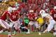 Aug 31, 2013; Lincoln, NE, USA; Nebraska Cornhuskers quarterback Taylor Martinez (3) rolls out against the Wyoming Cowboys at Memorial Stadium. Nebraska won 37-34. Mandatory Credit: Bruce Thorson-USA TODAY Sports