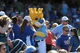 Sep 2, 2013; Kansas City, MO, USA; Kansas City Royals mascot Sluggerrr poses for photos with fans during the game against the Seattle Mariners at Kauffman Stadium. The Royals won 3-1. Mandatory Credit: Denny Medley-USA TODAY Sports