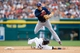 Sep 1, 2013; Detroit, MI, USA; Cleveland Indians shortstop Asdrubal Cabrera (13) leaps over a sliding Detroit Tigers catcher Alex Avila (13) as he makes a throw to first in an attempted double play during the seventh inning at Comerica Park. Mandatory Credit: Rick Osentoski-USA TODAY Sports