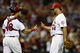 Sep 6, 2013; St. Louis, MO, USA; St. Louis Cardinals relief pitcher Edward Mujica (44) celebrates with catcher Tony Cruz (48) after defeating the Pittsburgh Pirates at Busch Stadium. St. Louis defeated Pittsburgh 12-8. Mandatory Credit: Jeff Curry-USA TODAY Sports