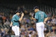 Sep 6, 2013; Seattle, WA, USA; Seattle Mariners catcher Mike Zunino (3) walks out to talk with Seattle Mariners relief pitcher Yoervis Medina (31) during the 7th inning against the Tampa Bay Rays at Safeco Field. Mandatory Credit: Steven Bisig-USA TODAY Sports
