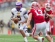 Sep 7, 2013; Madison, WI, USA; Tennessee Tech Golden Eagles quarterback Darian Stone (5) rushes with the football during the third quarter against the Wisconsin Badgers at Camp Randall Stadium.  Wisconsin won 48-0.  Mandatory Credit: Jeff Hanisch-USA TODAY Sports