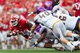 Sep 7, 2013; Madison, WI, USA; Wisconsin Badgers running back James White (20) is tackled with the football during the third quarter against the Tennessee Tech Golden Eagles at Camp Randall Stadium.  Wisconsin won 48-0.  Mandatory Credit: Jeff Hanisch-USA TODAY Sports