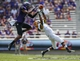 Sep 7, 2013; Fort Worth, TX, USA; TCU Horned Frogs safety Chris Hackett (1) intercepts the ball from Southeastern Louisiana Lions running back Xavier Roberson (1) during the second half at Amon G. Carter Stadium. Mandatory Credit: Kevin Jairaj-USA TODAY Sports