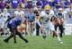 Sep 7, 2013; Fort Worth, TX, USA; Southeastern Louisiana Lions quarterback Bryan Bennett (3) runs past TCU Horned Frogs linebacker Marcus Mallet (54) during the game at Amon G. Carter Stadium. Mandatory Credit: Kevin Jairaj-USA TODAY Sports