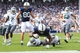 Sep 7, 2013; University Park, PA, USA; Penn State Nittany Lions Akeel Lynch (22) leaps into the end zone to score a touchdown during the fourth quarter against the Eastern Michigan Eagles at Beaver Stadium. Penn State defeated Eastern Michigan 45-7. Mandatory Credit: Matthew O'Haren-USA TODAY Sports