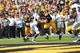 Sep 7, 2013; Iowa City, IA, USA; Iowa Hawkeyes running back Mark Weisman (45) scores a touchdown as wide receiver Jacob Hillyer (17) blocks Missouri State Bears linebacker Jeremy Springer at Kinnick Stadium.  Iowa beat Missouri State 28-14.  Mandatory Credit: Reese Strickland-USA TODAY Sports