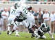 Sep 7, 2013; East Lansing, MI, USA; South Florida Bulls defensive back Kenneth Durden (23) is tripped up by Michigan State Spartans safety Kurtis Drummond (27) during the 2nd half at Spartan Stadium. MSU won 21-6. Mandatory Credit: Mike Carter-USA TODAY Sports