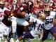Sep 7, 2013; Starkville, MS, USA;  Mississippi State Bulldogs running back Ashton Shumpert (32) knocks over Alcorn State Braves safety Anthony Williams (19) at Davis Wade Stadium. Mandatory Credit: Marvin Gentry-USA TODAY Sports